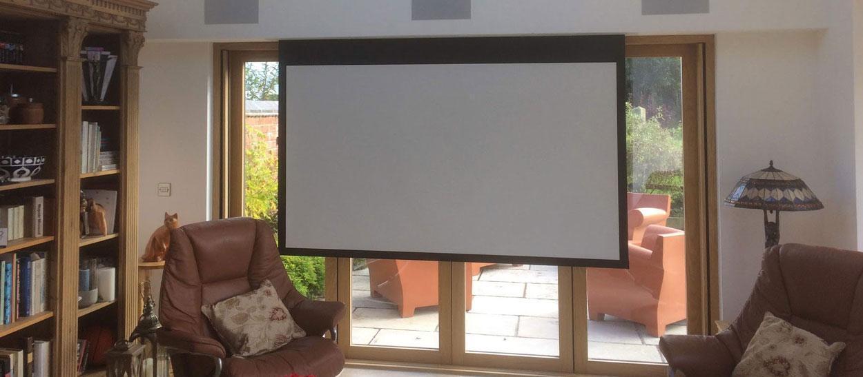 projector screen in front of bifold doors