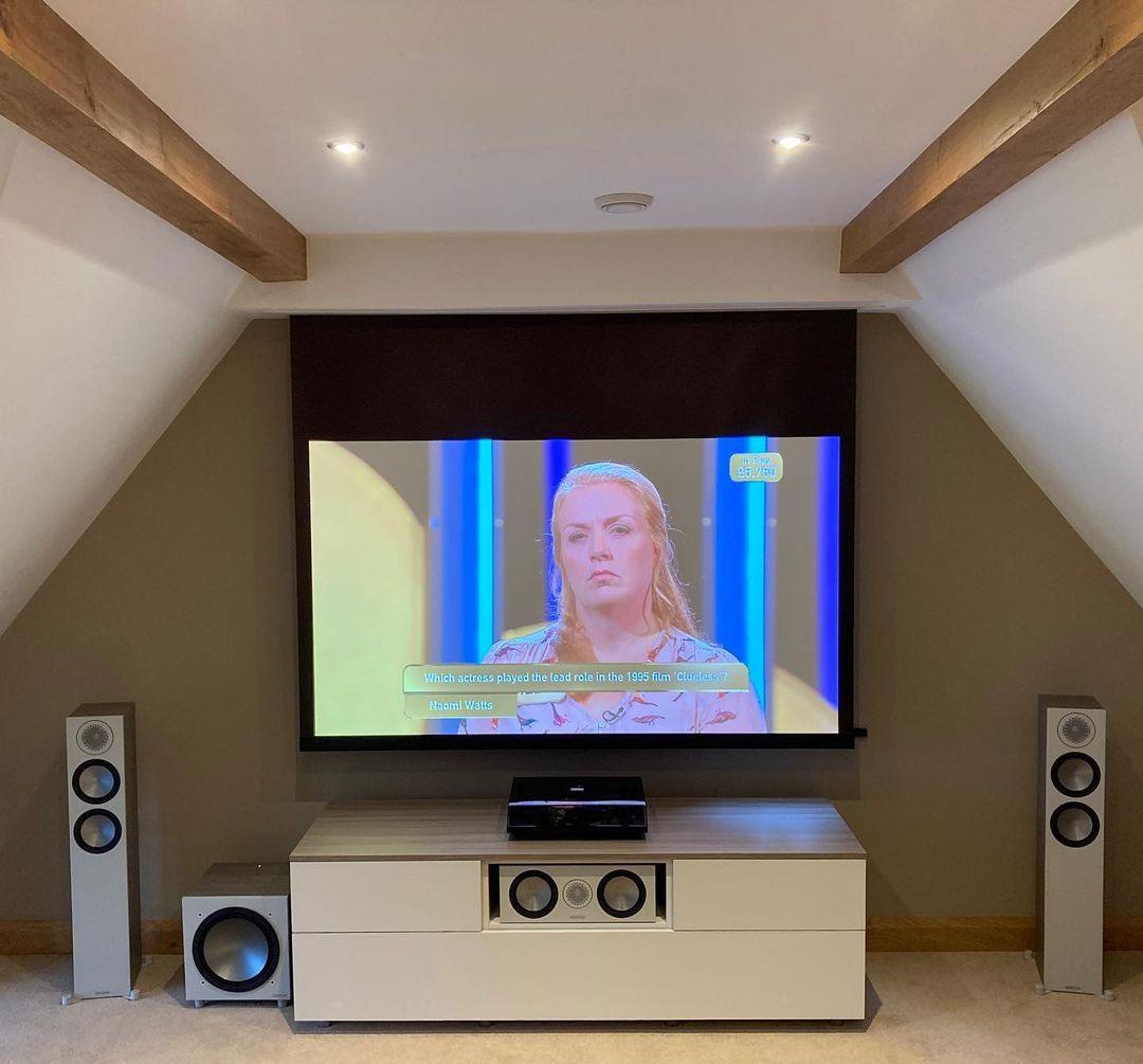 Recessed projector screen in loft