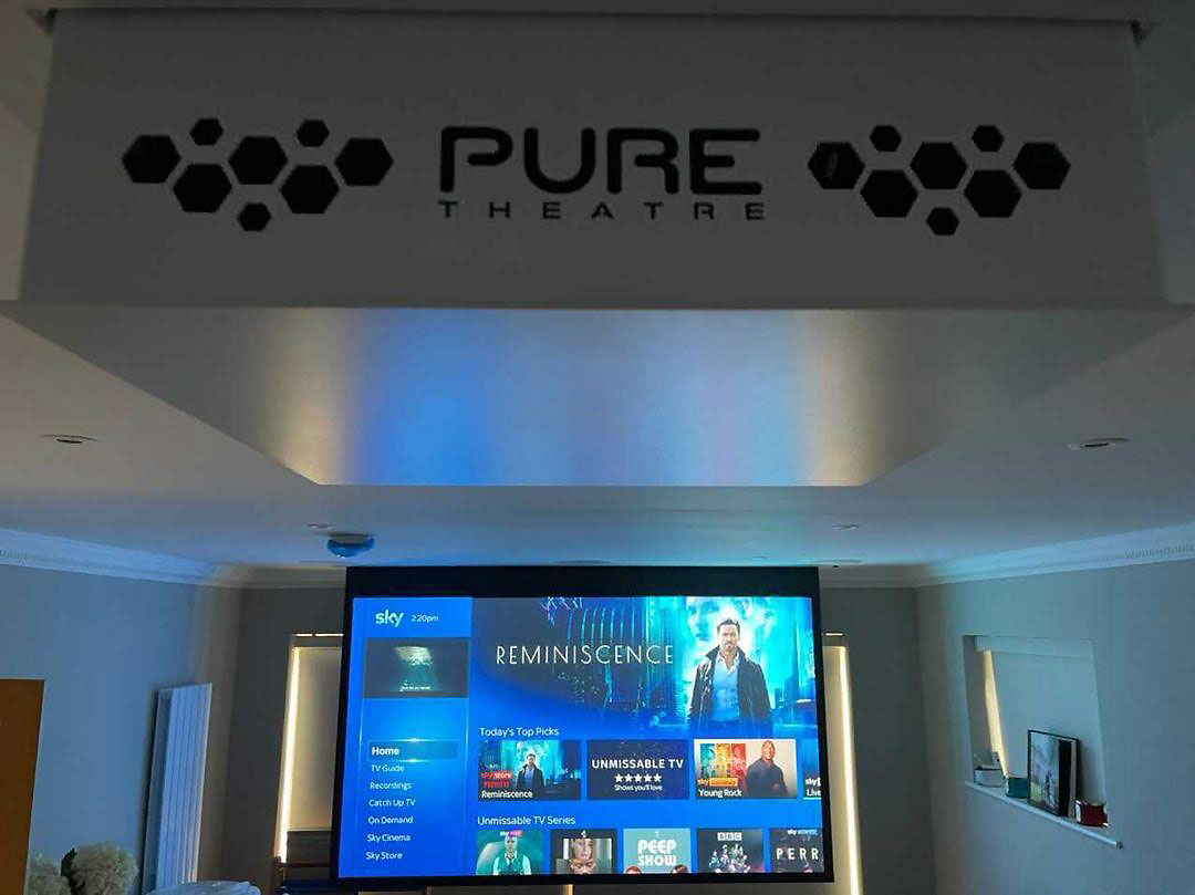 pure theatre projector lift down with projector screen behind with sky showing