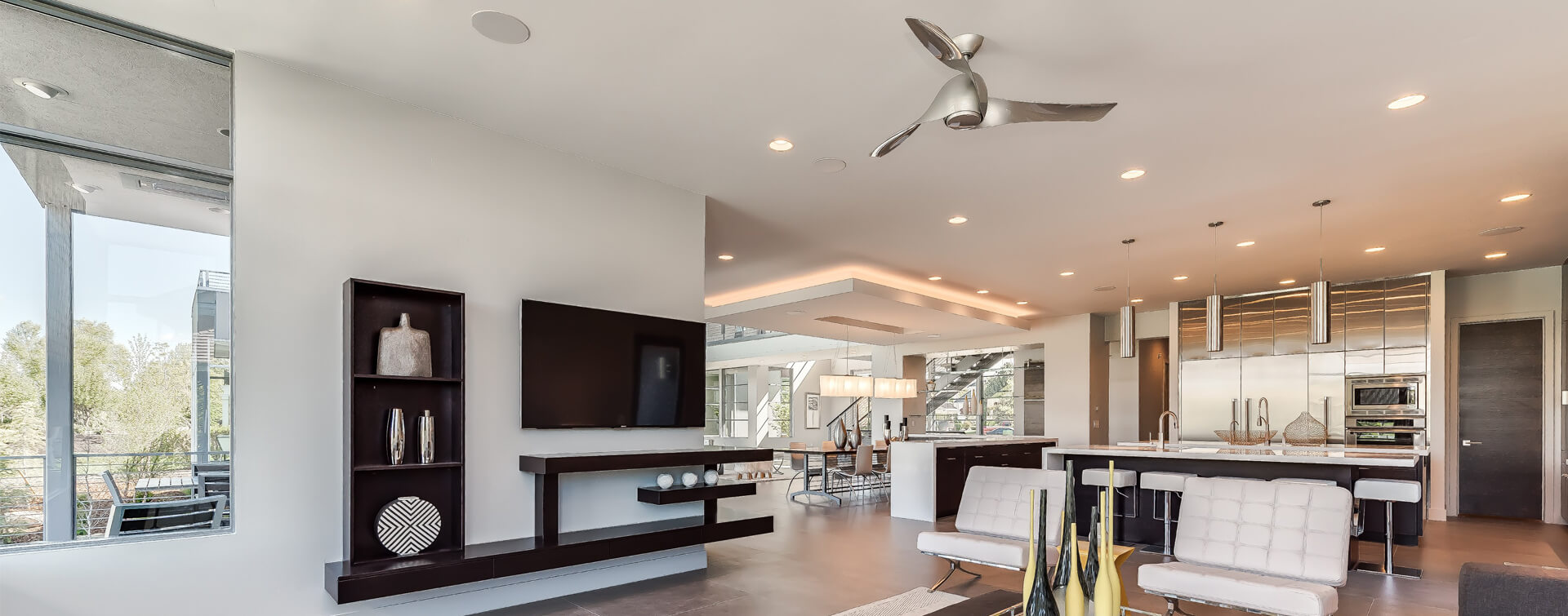 In ceiling speakers in a white open space large modern kitchen