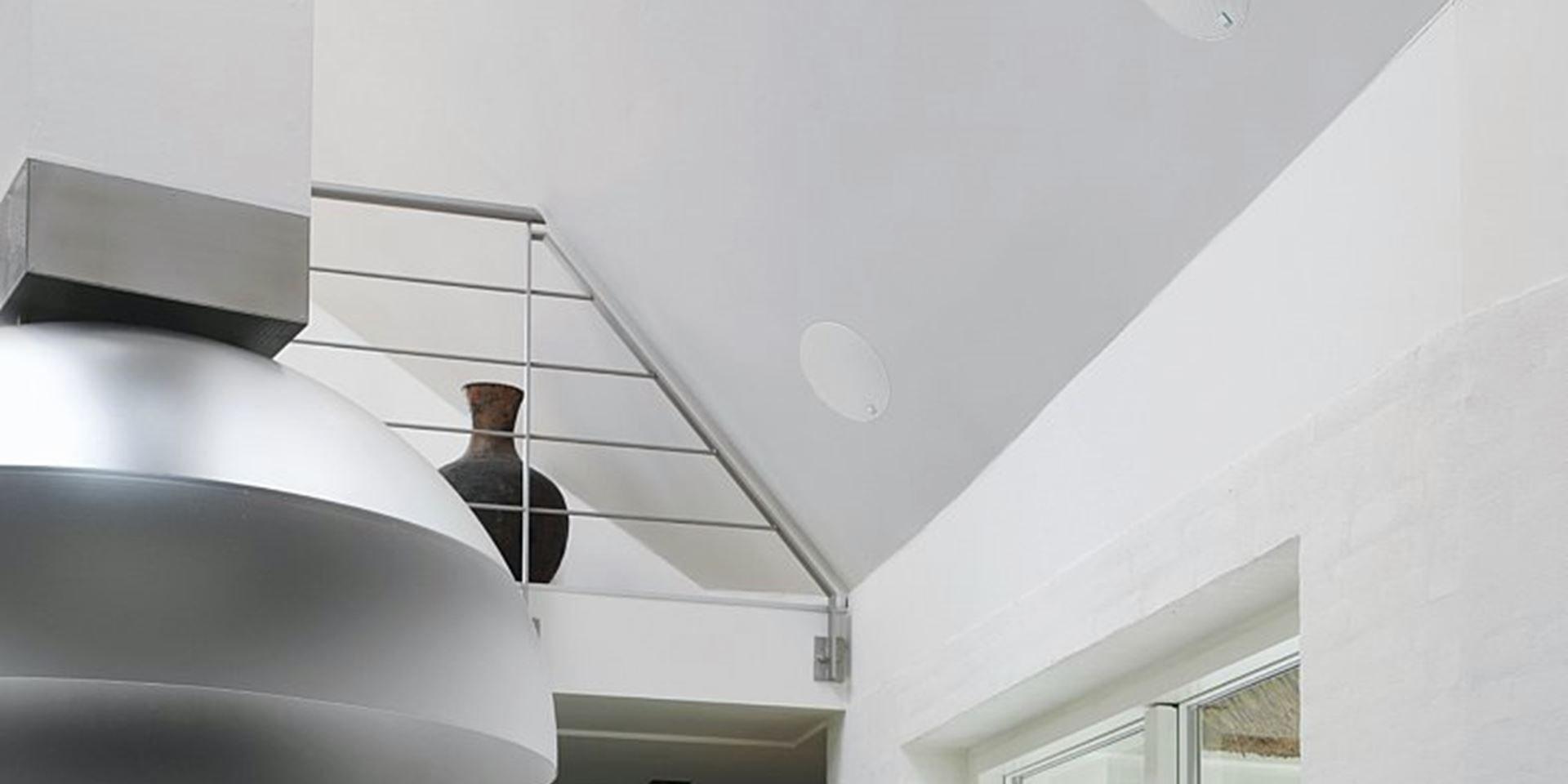 In Ceiling Speaker on slanted white wall in modern house