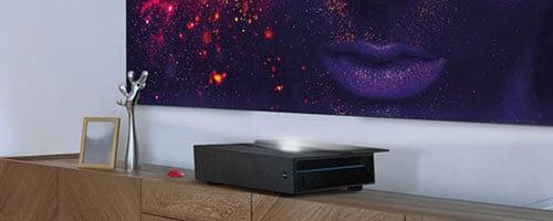 Benq V6050 Ultra Short Throw Projector on cabinet